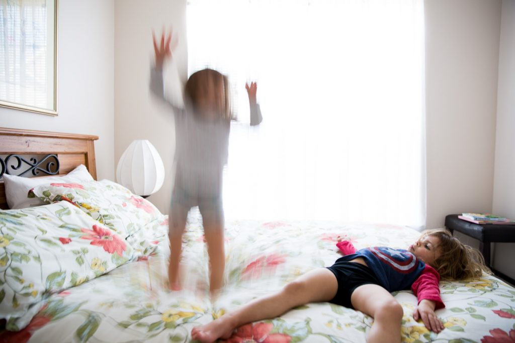 9/52 girls jumping on bed new orleans photographer